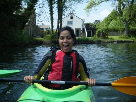Smiling lady kayaking on Ullswater