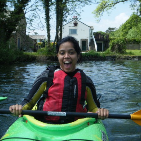 Smiling lady kayaking on Ullswater