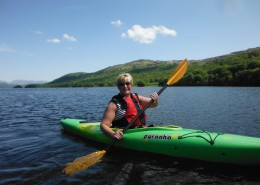 female kayaker on a sunny day on coniston Water