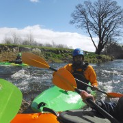 Kayaker gaining river skills for BCU kayak 3 star award