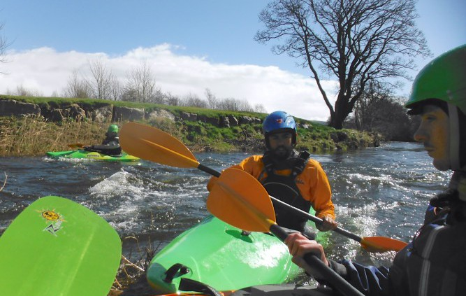 Kayaker gaining river skills for BCU kayak 3 star award