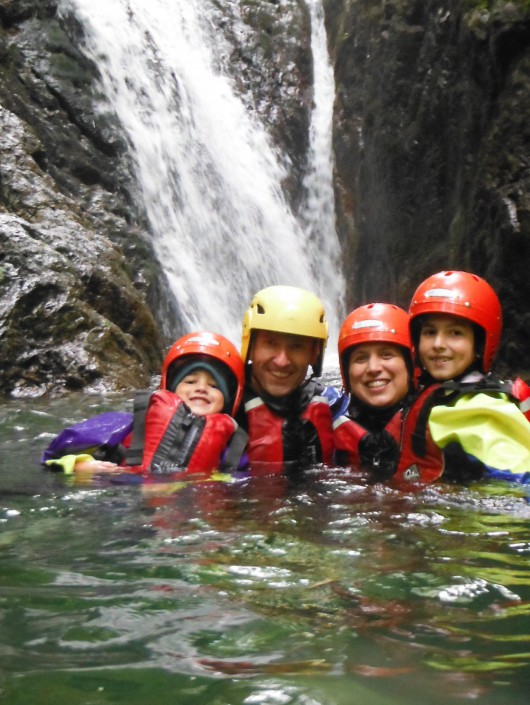 Family group relax after ghyll scrambling