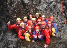 A team enjoying an adventurous team building day - ghyll scrambling with Dave's Adventure Company
