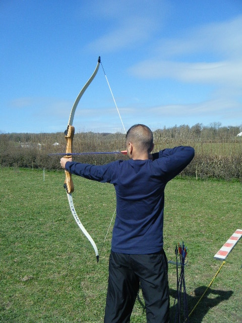 An archer releasing an arrow
