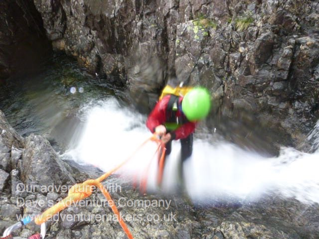 Arran the New Adventure Maker climbing down a canyon