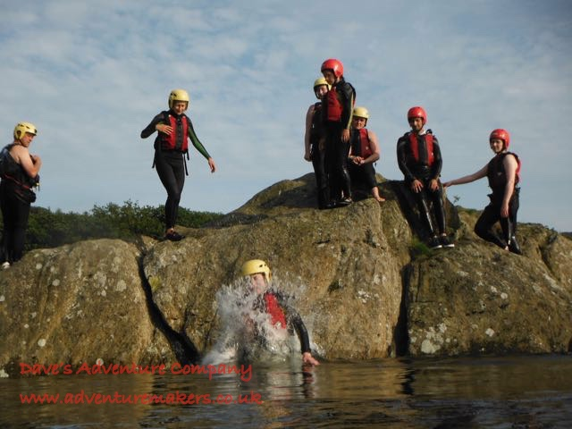 Jumping of the Rocks into the Lake with the Adventure Makers