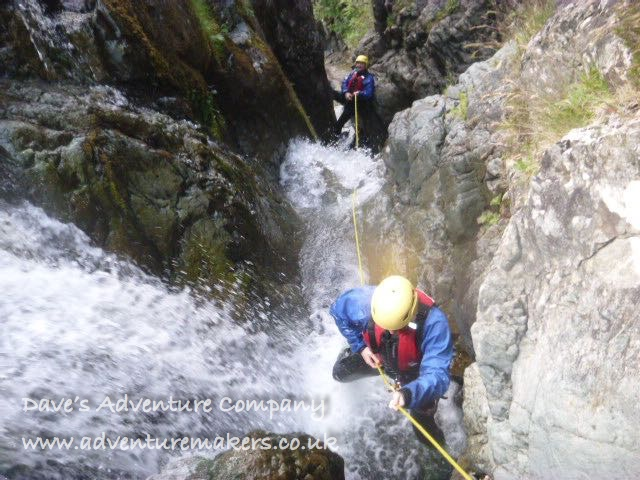 Abseiling down a canyon at the Scottish Canyoning Symposium